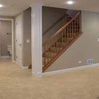 finished basement with tan walls and beige carpet