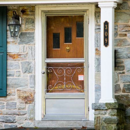 old wooden door and storm door