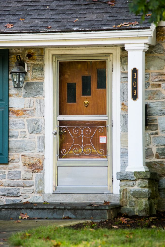 old wooden door and storm door
