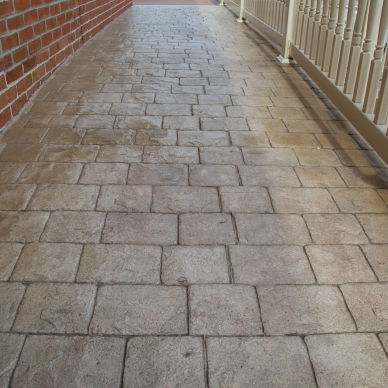 concrete walkway with vinyl railings
