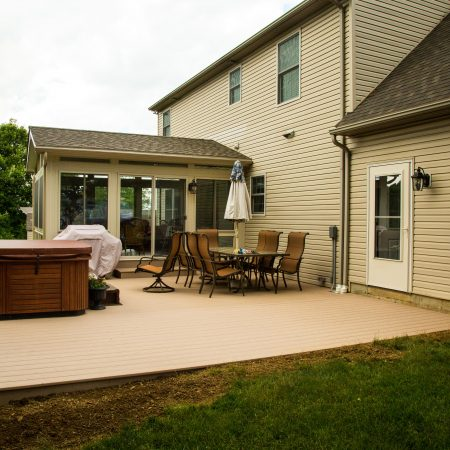 deck with hot tub and furniture