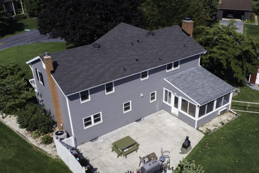 aerial view of home with new vinyl siding