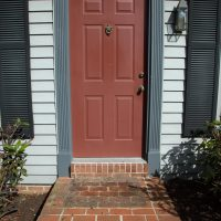 weathered red entry door