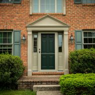 green entry door with storm door