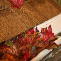 clogged gutter and gutter with leaf guard