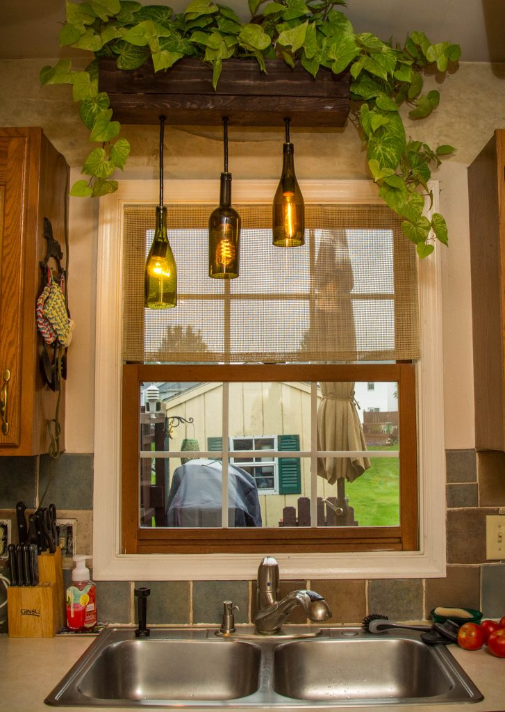 old wooden window in kitchen in need of replacement