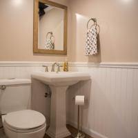 remodeled bathroom with pedestal sink