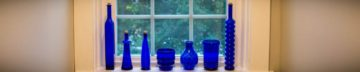 blue bottles displayed in a newly replaced window