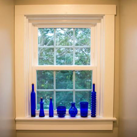 blue glass bottles along a window sill