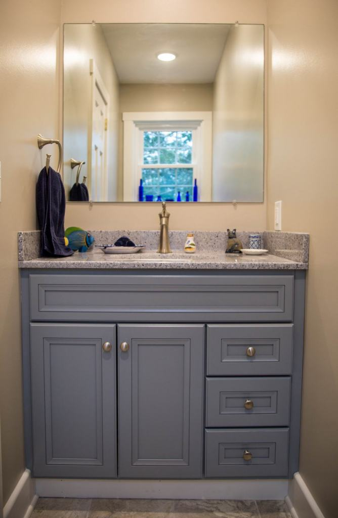 bathroom vanity with gray cabinets and countertop