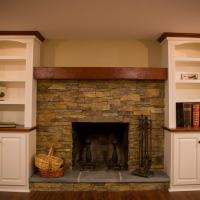 fireplace with built-in side shelving