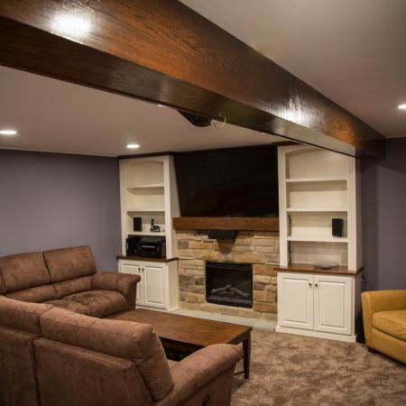 finished basement with fireplace and entertainment center