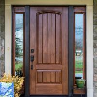 wooden entry door with side windows