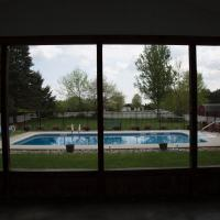 outdated patio enclosure with view of pool