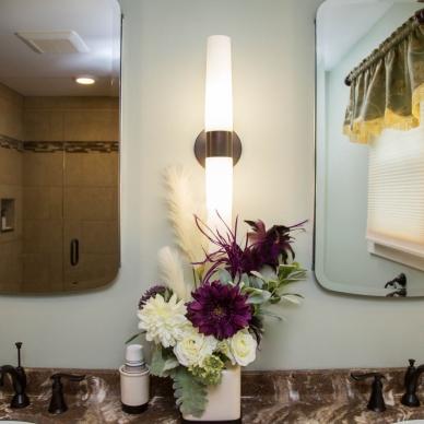 detail of dual mirrors of remodeled bathroom vanity