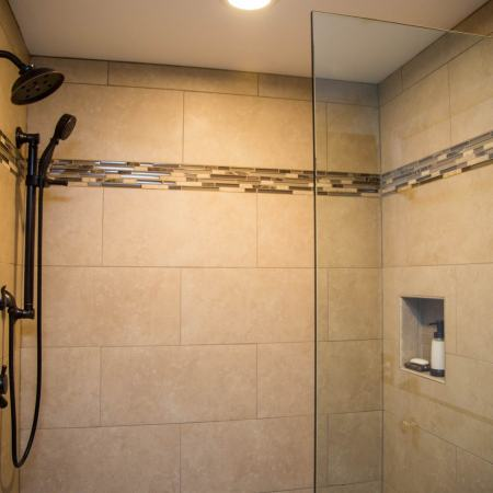 closeup of walk-in shower unit with custom tile