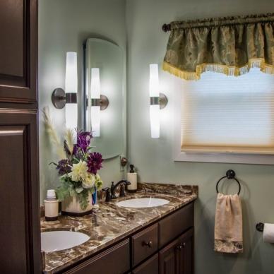remodeled bathroom with dual vanity sinks