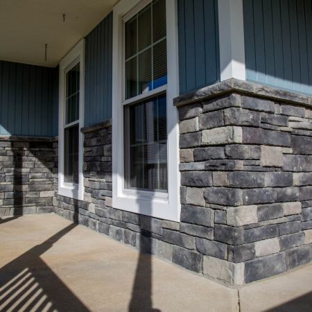 addition of stone wall to lower portion of front porch siding
