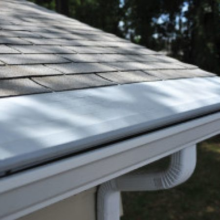 winter gutter maintenance- gutter with leaf guard
