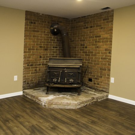 finished basement with wood stove
