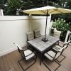 new deck with privacy fence and deck furniture