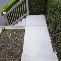 concrete walkway and vinyl railings