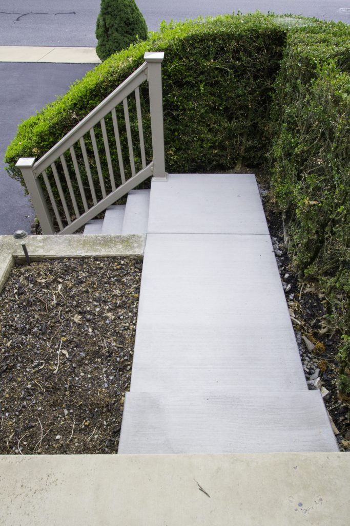 concrete walkway and vinyl railings