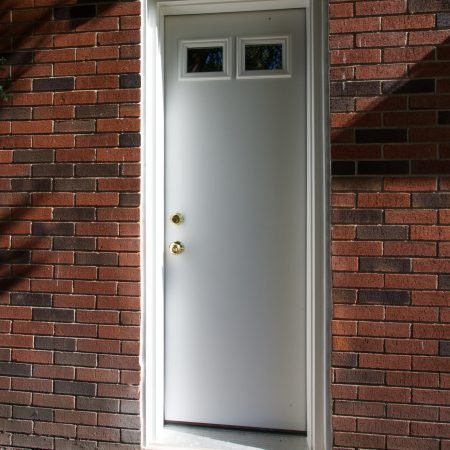 white replacement door with two small upper windows