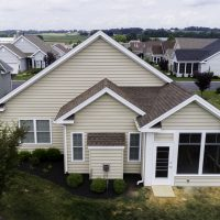 aerial view of house with new deck and sunroom