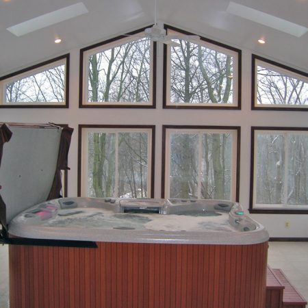 interior of sunroom with a hot tub