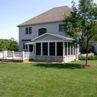 finished sunroom addition with deck