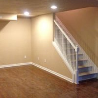 finished basement stairs and hardwood floors