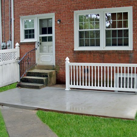 new concrete steps to basement and patio with railing