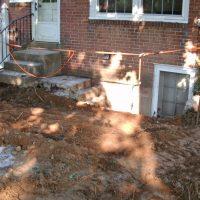 broken concrete steps to basement