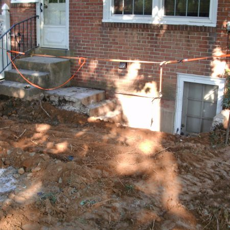 broken concrete steps to basement