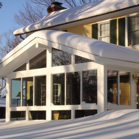 sunroom addition in snow