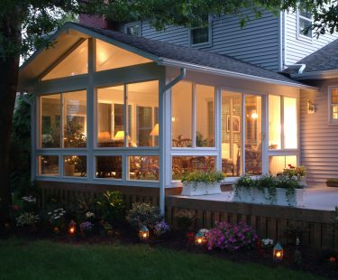 sunroom lit at dusk