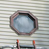 streaked weathered octagonal window