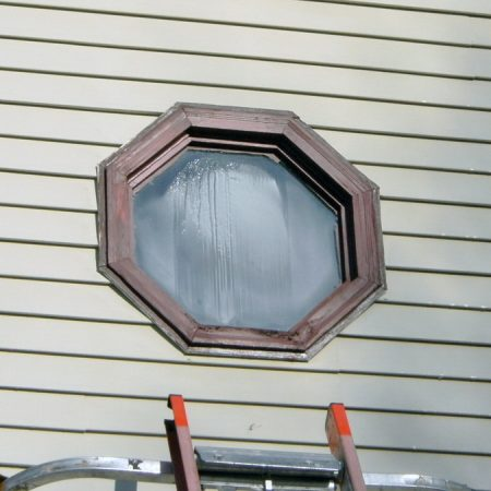streaked weathered octagonal window