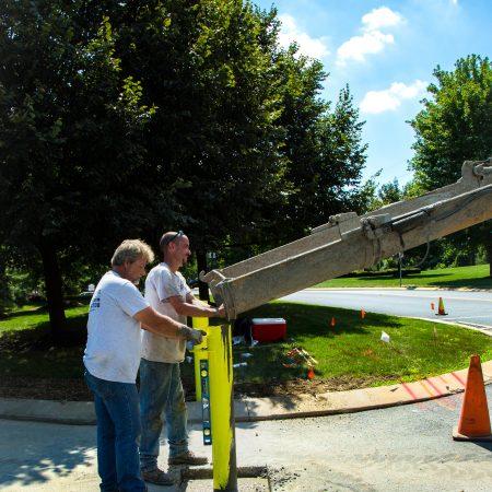 pouring concrete into gate post