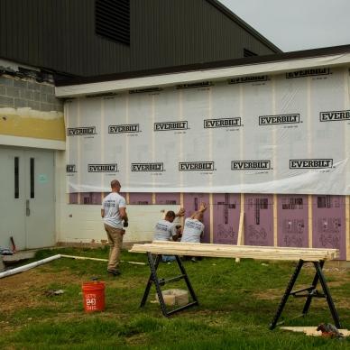 removing old concrete bricks and adding homewrap