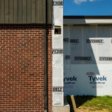 homewrap on building. prep for siding installation