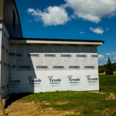 building prepped for siding installation