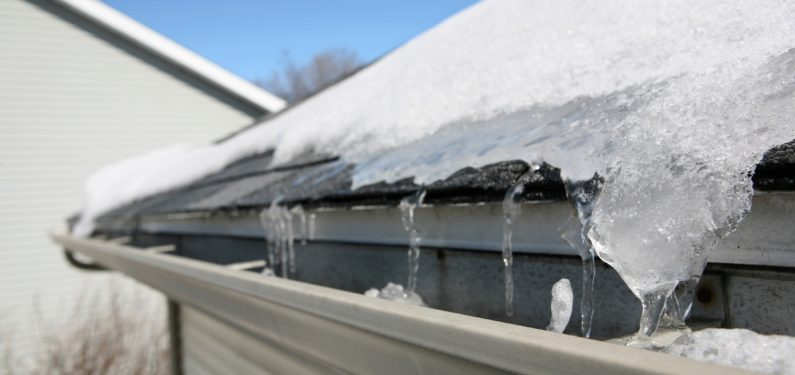prevent winter roof & gutter damage - ice and snow on roof and gutter