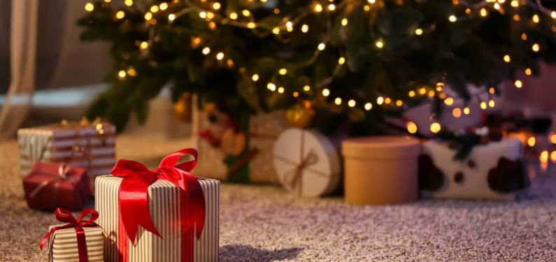christmas presents on the floor under a tree